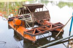 Old orange wastewater treatment machine in thailand Stock Photos