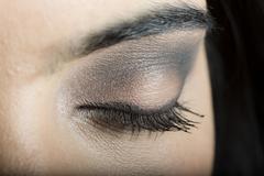 Close up of makeup on eyelid of Hispanic woman Stock Photos