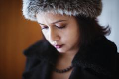 Mixed race woman wearing furry hat and coat Stock Photos