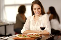 beautiful woman in a pizza restaurant. - stock photo