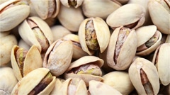 Stock Video Footage of roasted salted appetizing pistachios rotating