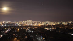 Urban residential streets with busy traffic under rising moon, Toronto Stock Footage