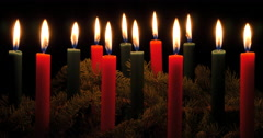 Rows of red and green Christmas candles  - stock footage