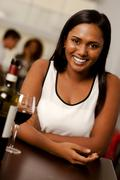 Stock Photo of beautiful young indian woman in a restaurant
