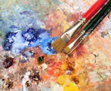 artistic equipment: paint, brushes, spatula and art palette - stock photo