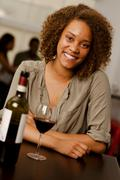Beautiful mixed-race woman in a restaurant Stock Photos