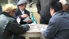 Chinese men plays cards 4080 Stock Footage
