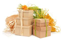 Stock Photo of gift boxes tied with natural raffia of different colors and topped with a flo