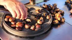 Street vendor roasting chestnut closeup in Istanbul Turkey - stock footage