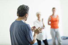 Teacher talking to students in acting class Stock Photos