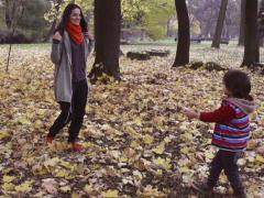 Happy mother walking with son, steadycam shot, slow motion shot Stock Footage