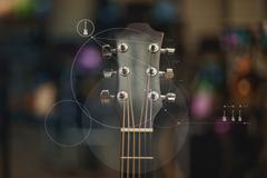 Close up of guitar overlaid with graphic design Stock Photos