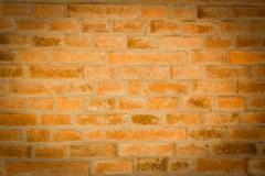 red brick wall texture background with vignetted corners to interior design - stock photo