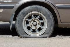 Flat tyre in sunshine Stock Photos