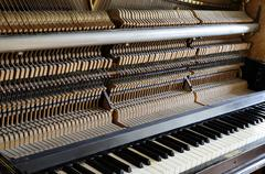 inside the piano: string, pins and hammers - stock photo