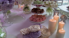 Dessert table richly decorated with flowers Stock Footage
