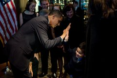 President Barack Obama high fives with a boy at a fundraiser for Bill Owens,  Free Stock Photos