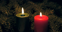 Red and green Christmas candles with spruce boughs - stock footage