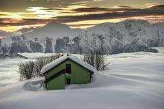 Alpin hut in the snow during sunset Stock Photos