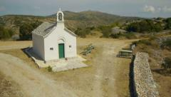 Small church on island hill Stock Footage