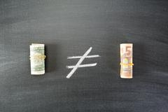 compare us dollar to euro - stock photo