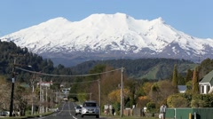 Snow covered Mount Ruapehu and street scene Stock Footage