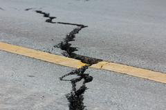 Broken road by an earthquake in chiang rai, thailand Stock Photos