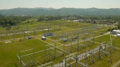 Aerial rear view over high-voltage line, Electricity Substation Stock Footage
