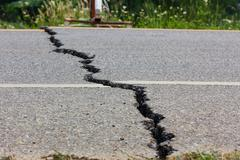 broken road by an earthquake in chiang rai, thailand - stock photo
