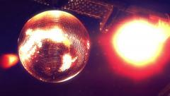 Colorful Disco mirror ball ceiling lighs at 70's disco Stock Footage