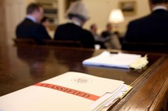 A classified folder rests President Barack Obama's desk during a morning meet Free Stock Photos