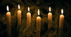 Row of white Christmas candles with spruce boughs Stock Footage
