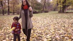 Mother with son walking in the park, steadycam shot, slow motion shot - stock footage