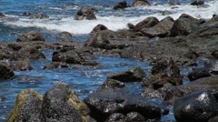 Waves against rocks in Hilo Stock Footage