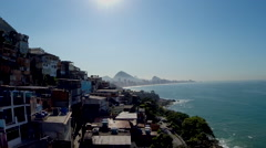 Rio hillside favela - aerial drone shot w Christ the Redeemer in background Stock Footage