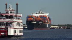 Apl belgium container ship and tour boat, savannah river, ga, usa Stock Footage