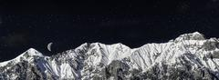 chain of mountains in winter in the night - stock photo