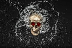 Skull splash Stock Illustration