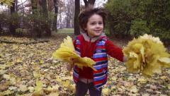 Boy running to the camera in the park, steadycam, slow motion shot at 240fps Stock Footage