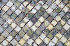 very old and aged square tiles on the floor - stock photo