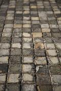 Very old and aged square tiles on the floor Stock Photos