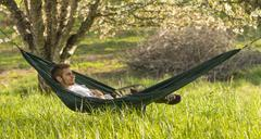 country man in hammock - stock photo