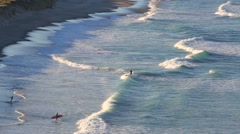 Spring time surfing on a sandy beach Stock Footage