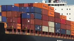Stock Video Footage of close up of containers on ship as it steams up the savannah river, ga, usa