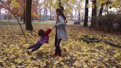 Mother twisting with her son, steadycam shot, slow motion shot at 240fps Stock Footage