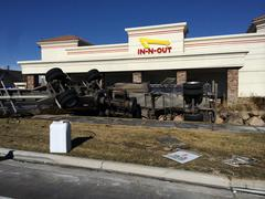 Semi Trailer carrying milk rolled over into In-n-Out restaurant property. Stock Photos