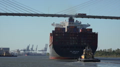 Container ship passes under talmadge bridge, savannah river, ga, usa Stock Footage