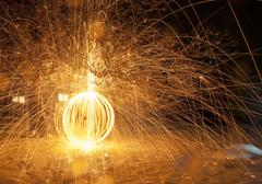 fiery light painting sphere over snow - stock photo