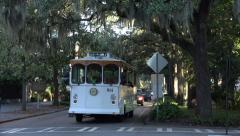 Tour trolley bus drives down typical street in savannah, ga, usa Stock Footage