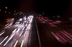 freeway traffic at night time. long exposure - stock photo